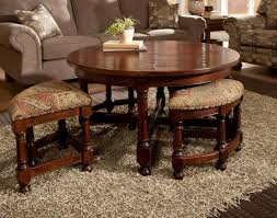 round coffee table with ottomans underneath chairs seating