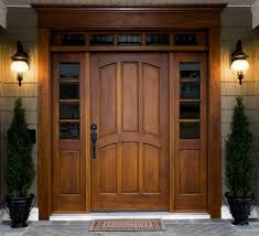 this set of teak wood front door and supporting frames with gl panels is perfect for a traditional indian home in case your interiors are also modeled