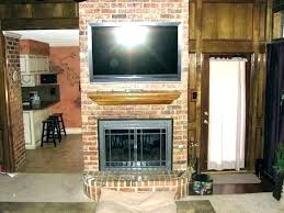 hanging tv over fireplace mounting a over a fireplace over fireplace too high above club how