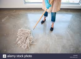 janitor school stock photos janitor school stock images alamy w cleaning a concrete floor a wet mop wearing apron and latex gloves