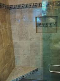 pinwheel tile accent on seat niche and walls brings the whole design together for this full height shower surround
