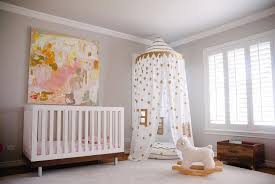 pink and gold nursery with gold confetti canopy