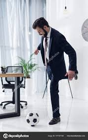 Young Businessman Suit Playing Soccer Office Stock Photo