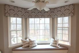 Bay Cornice Board - I like this idea to bring the windows together and  unify the space.