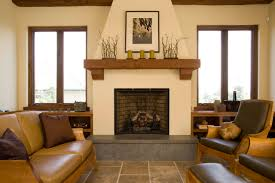 fireplace with fireplace mantel and wood mantels and armchairs also leather sofa plus tall windows and tile floors and wood trim for terranean living