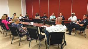 police officers and citizens meet during a community roundtable discussion in may