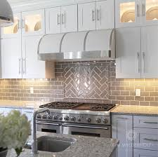 kitchen backsplash glass subway tile. White And Gray Kitchen Design With Glass Subway Tile, White Range  Hood, Cambria Quartz: By Kim Wiederholt Design Backsplash Tile A
