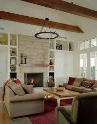 bookshelves next fireplace with velvet decorative pillows living room rustic and couch