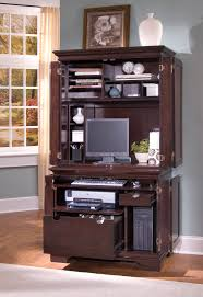dark brown wooden computer desk with hutch and doors also file storages on the floor