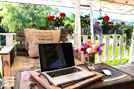 outdoor home office. a flower filled outdoor patio office via funky junk interiors home