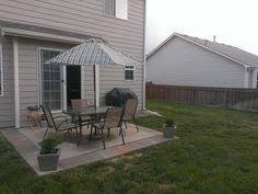 DIY Patio Expansion add 16x16 pavers around builder grade patio to