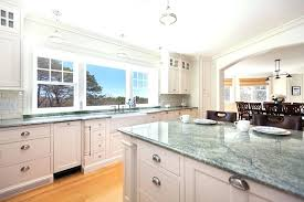countertops for white kitchen cabinets traditional kitchen with white cabinets and tropical green granite counters thunder