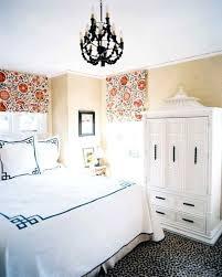 chandelier over bed black bedroom chandelier over bed with white bedding in the bedroom with locker chandelier over bed