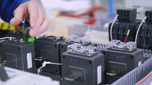 the assembling of electric fuses in fuse box no face close up 4k how to put a wire into a fuse box unrecognizable electircian installing electric equipment, breakers, battery into electrical fuse box at the industrial