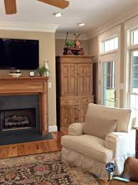 wood colours for furniture. lenox tan benjamin moore in warm farmhouse style living room with oak pine and wood colours for furniture
