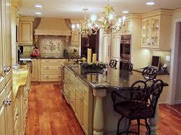 beautiful kitchen chandelier design over white kitchen island with granite countertop