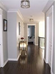 dark floors soft grey wall color and white moulding
