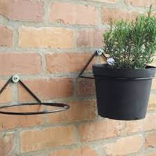two plant pot ring mounted on the wall