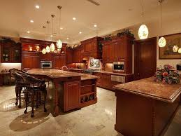 Open Kitchen Island Designs Open Kitchen With Stained Wood Cabinetry And Twotier Island With