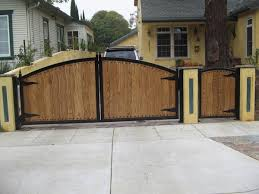 Mailbox at front gate. Love this entrance design / front yard privacy fence
