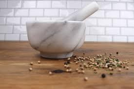 white marble mortar pestle