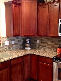 Red And Gold Kitchen Cherry Cabinets And Venetian Gold Granite Countertops In Kitchen
