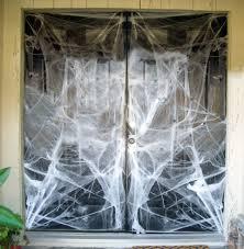 DIY Halloween Door Decorations: Door Wrapped in Spider Webs