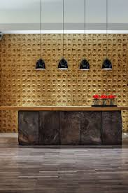 this spa reception area has a large desk with the dark stone contrasting the wooden feature wall best of interior large desk