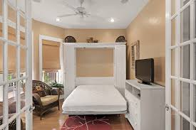 bedroom on the first floor has a queen size murphy bed lg flat screen tv