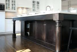 mullet cabinets kitchens dark stained kitchen island turned wood legs natural stone counters hardwood canada