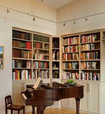 view in gallery track lighting is an ideal way to light up home libraries and bookshelves