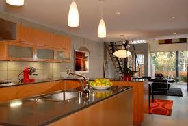 Kitchen Design For Apartment Dazzling Modern Kitchen Design With Orange Base Cabinet And Glass