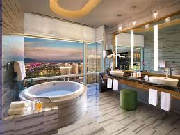 the bathrooms inside aria s glamorous sky suites boast floor to ceiling windows with views of the vegas valley oversize spa tubs and steam showers