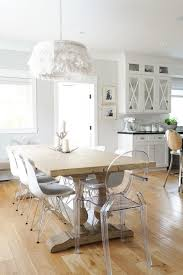rustic dining table with eames chairs. reclaimed wood baluster dining table with ghost chairs and white feather chandelier rustic eames n