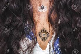 Girl With Gold Flash Tattoo And Long Black Hair
