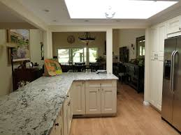 Raised Kitchen Floor Traditional Kitchen With Flat Panel Cabinets Skylight In
