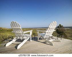 adirondack chairs on beach. Stock Photograph - Two Adirondack Chairs On Wooden Deck Overlooking Beach  At Bald Head Island, W