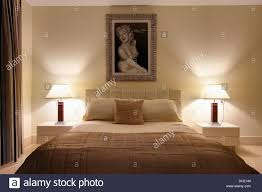 Marilyn Monroe Bedroom Framed Picture Of Marilyn Monroe Above Bed With Beige Quilt In