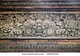 carved stone fence of traditional hindu temple with demon guard indonesia bali traditional balinese on indonesian carved wall art with carved stone fence traditional hindu temple stock photo royalty
