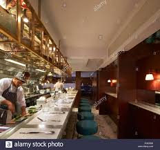 Restaurant open kitchen Chef Open Kitchen With Bar Counter Seating And Chefs At Work The Palomar Restaurant London United Kingdom Architect Gundry Duc Alamy Open Kitchen With Bar Counter Seating And Chefs At Work The Palomar