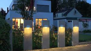 extraordinary idea for contemporary outdoor lighting fixtures on concrete panels near wide green grass yard