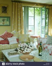 Patterned Curtains For Living Room Cream Patterned Vanessa Arbuthnot Sofa With Matching Curtains On
