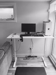 into our new place today upgraded my standup desk been working gaming at a coffee table on top a tv cabinet since seattle s t co h1w12rknqg