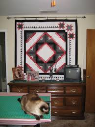 How do you hang your wall quilts without making holes in the wall? & Attached Images Adamdwight.com