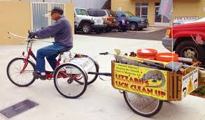 bicycles of all sorts are on monterey bay region bikeways that includes this sling of people making use of a variety of trailers cargo bikes