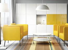 Living Room Cabinet With Doors A Living Room With Yellow Armchairs A White Round Coffee Table