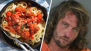 drunk shirtless florida man shovels spaghetti in his mouth at olive garden