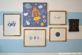 robot space art in nursery gallery wall with free blast off printable  on robot nursery wall art with nursery art gallery wall with free printable balancing home