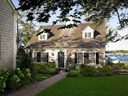 cape cod style dormer addition exterior beach style with summer home traditional slab doors
