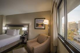 a bed or beds in a room at hilton garden inn reagan national airport
